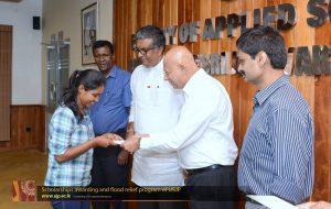 Scholarships awarding and flood relief program of USJP